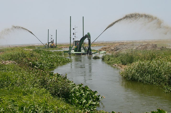 Two watermasters dredging