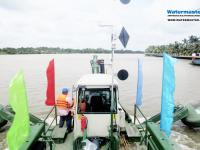 Watermaster, the self-propelled Multipurpose river Maintenance and Cleaning machine cruising to the worksite, Vietnam.