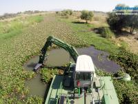 Multipurpose Watermaster Dredger Revitalizing a shallow river by Removing invasive water hyacinth and Dredging out silt, Mexico.