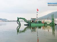 Amphibious Multipurpose Watermaster Cleaning a lake in Vietnam