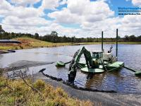 Amphibious Multipurpose Watermaster Recovering coal fines from settling ponds by suction dredging the wet coal ash into dewatering bags, Australia