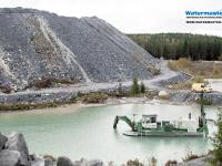 Amphibious Watermaster dredger cleaning a process water pond at a gold mine