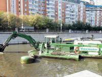 Multipurpose Watermaster Dredger Desilting and Cleaning an urban canal, Russia
