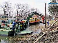 Multipurpose Watermaster Dredger Reinforcing riverbanks by installing sheet pile walls, which help to prevent floods and erosion, Poland
