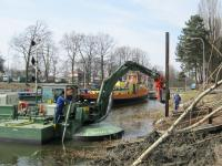 Multipurpose Watermaster dredger doing piling work