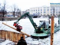 Multipurpose Watermaster dredger Installing timber piles