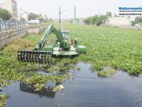 Watermaster dredger removing invasive water hyacinth from Chennai's canals