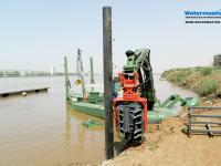 Watermaster dredger pile driving to build docks for tourist boats