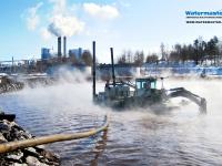 Watermaster dredger cleaning a paper mill wastewater treatment pond by suction dredging