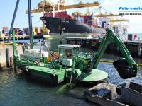 Watermaster dredger maintenance dredging a shallow part of a port