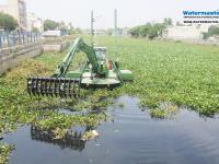 Watermaster dredger removing invasive water hyacinth from Chennai's canals, India
