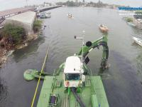 Watermaster dredging to keep the busy Negombo Lagoon clean and navigable, Sri Lanka