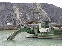 Watermaster dredger pumping sediments from a process water pond at a gold mine