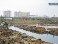 Watermasters Desilting a stormwater management pond to reduce the risk of flooding, Indonesia