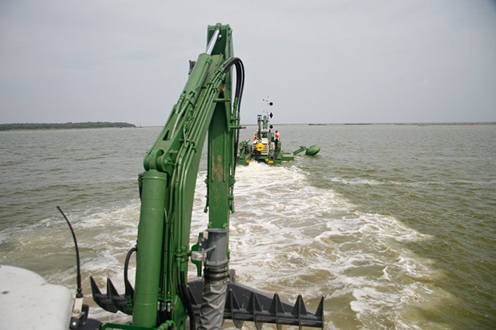 Two Watermaster dredgers travelling on water
